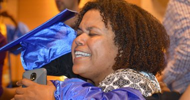 Happy Student graduates with GED with Beyond Literacy in Philadelphia, PA